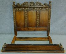 An antique style Ipswich oak standard double bedstead carved with floral motifs. H.144 W.220 D.152cm