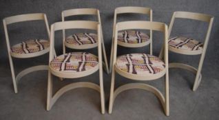A set of 1970's vintage dining chairs of modernist design with original abstract design seat
