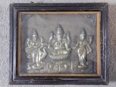 An antique framed and glazed engraved relief picture of Indian deities in white metal. Stamped to