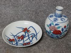 A Meji period Japanese hand painted Nabeshima porcelain plate with floral design along with a Meji