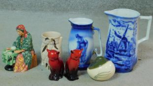 A miscellaneous collection of ceramic items. Including a pair of Royal Doulton flambe glaze seated