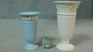 A collection of antique Wedgwood including two embossed Queensware trumpet vases along with a dark