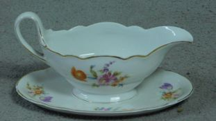 A Hutschenreuther, LHS porcelain gravy boat on stand with hand painted floral design. Makers stamp