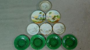 A collection of antique plates. Including four green glazed majolica plates, three with vine