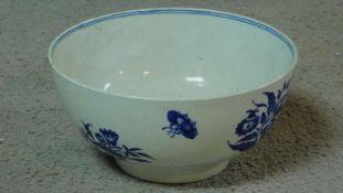 An 18th century blue and white hard paste porcelain Worcester footed bowl with floral and insect
