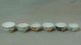 A collection of six antique hand painted porcelain tea bowls. Including four Chinese hand painted