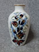 A vintage Russian handpainted and gilded bird and flower design porcelain vase by Polonne. Makers