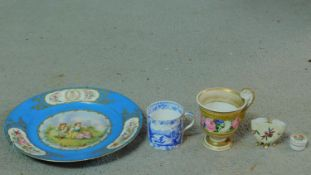 A miscellaneous collection of porcelain items. Including an antique hand painted porcelain patch