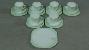 An Art Deco Duchess china hand painted abstract design tea set. Includes six cups and saucers, six