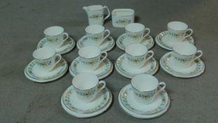 A Royal Doulton fine bone china part tea service 'Pastorale' pattern with delicate floral design.