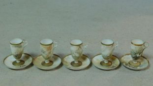 Five antique Japanese egg shell porcelain hand painted tall stemmed cups and saucers. Each one