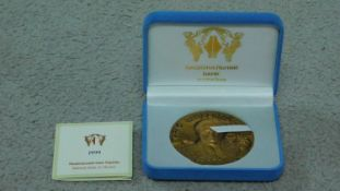 A cast copper commemorative double sided medal from the National Bank of Ukraine, 1999.