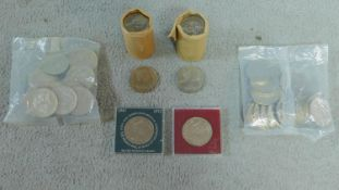 A collection of coins including two rolls of uncirculated crowns, commemorating Queen Elizabeth