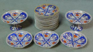 A collection of eighteen antique hand painted and gilded porcelain plates, three footed bowls and