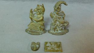 A pair of Victorian Punch and Judy brass door stops along with a repousse brass Christmas scene