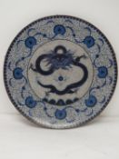 A 20th Japanese blue and white cloisonné enamel bronze footed charger with dragon and flaming