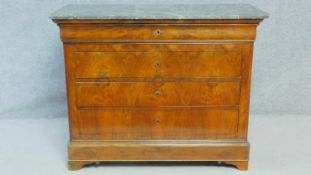 A late 19th century French Louis Philippe burr walnut commode with grey veined marble top and four