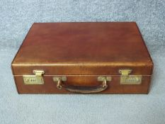 A vintage tan hide Harrods documents attaché case. With a pale suede interior and expanding