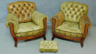 A pair of late 19th century mahogany and satinwood inlaid club armchairs in deep buttoned leather
