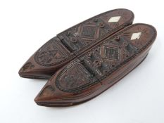 A Georgian carved wooden snuff box in the form of a pair of slippers with engraved geometric and
