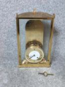 A limited edition rectangular, semi-circular section, gilt brass, glazed with bevelled glass cased