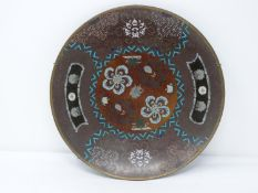 A 20th century Japanese cloisonné enamel footed plate with a stylised floral design and central
