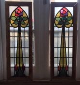 A pair of framed Art Nouveau lead stained glass window panels with abstract floral design. H.90 W.