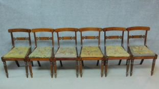 A set of six George IV faux rosewood and satinwood inlaid bar back dining chairs with drop in