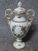 A handpainted and gilded porcelain 'Indian Basket multicolour' design Herend two handled lidded urn.