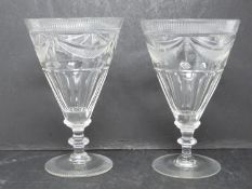 A pair of hand engraved blown glass Georgian rummers. Radiating design to the foot and rim of