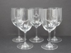 A set of five Baccarat crystal water glasses. Signed and stamped to the foot. H 15.5cm.