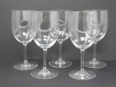 A set of five Baccarat crystal wine glasses. Signed and stamped to foot. H16.5cm