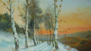 A framed oil on board of silver birches in a wintery scene, signed by Cardil. 76x96cm