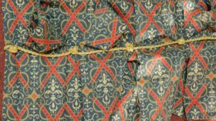 A set of four fabric curtains with stylised fleur-de-lis motifs and X and scrolling design. Silk