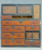 A Japanese Sendai-Tansu two section kimono chest with an arrangement of eleven drawers and panel