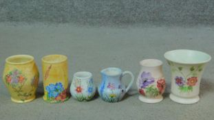 A collection of five vintage hand painted Radford Pottery vases and a jug. Two with yellow