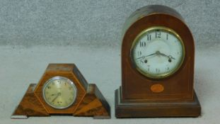 Two mahogany and inlaid mantle clocks. One Smith's electric Art Deco clock with abstract design