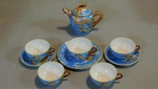 A hand painted vintage Japanese Lithophane tea set. The five cups have pictures of Geishas when held