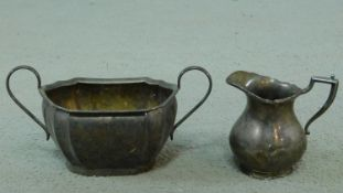 Two sterling silver items including an Edwardian milk jug with fluted rim and linear design