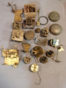 A collection of antique brass clock and watch mechnisms including strikers,bells, barrells and other