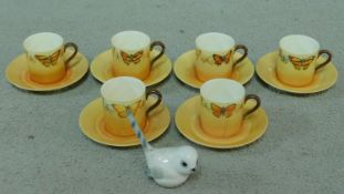 A hand painted Collingwood porcelain coffee set decorated with various butterflies along with a