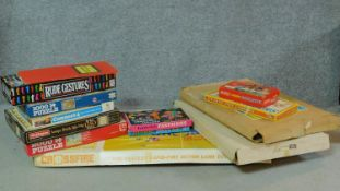 A collection of vintage board games and puzzles to include 'Snakes and ladders' and 'Crossfire'.