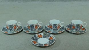 A Japanese floral design porcelain tea set, artist's signature to the base. Decorated with Camelia