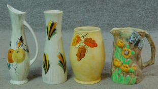 A collection of vintage hand painted Radford pottery pieces. One jug is Butterflyware with a moulded