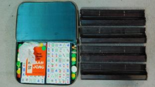 A vintage green and white plastic hand carved tricolour Mahjong set in leather effect zip up case.