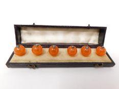 a cased set of antique carnelian waistcoat buttons. L12cm