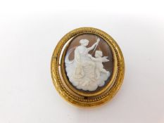 A Victorian reversible pinch beck cameo mourning brooch. One side has a carved shell cameo and the