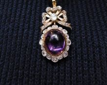 A victorian Amethyst and diamond pendant. Set with an oval amethyst cabochon with an approximate