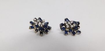 A pair of vintage white metal and yellow metal sapphire and diamond abstract clip earrings. Each