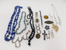 A collection of vintage jewelery. Including a micro mosaic cross with flowers and a dove of peace, a